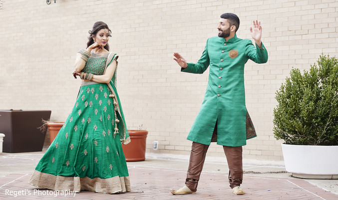 Indian bride and groom having fun during photo shoot.