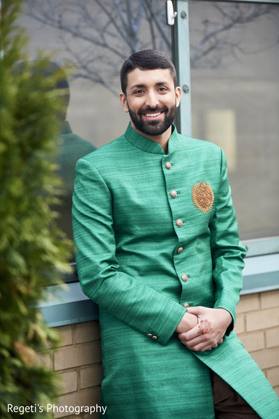 Indian groom during photo session.