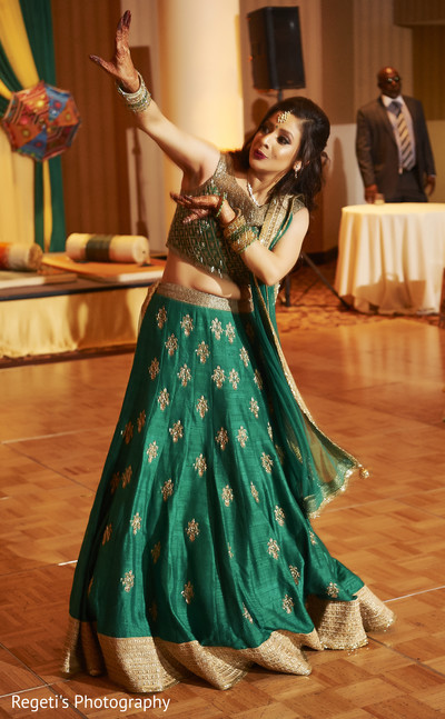Indian bride during her Sangeet performance.