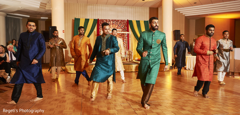 Indian groom and his groomsmen performing during the sangeet.