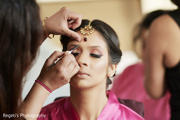 Maharani getting her make up done.