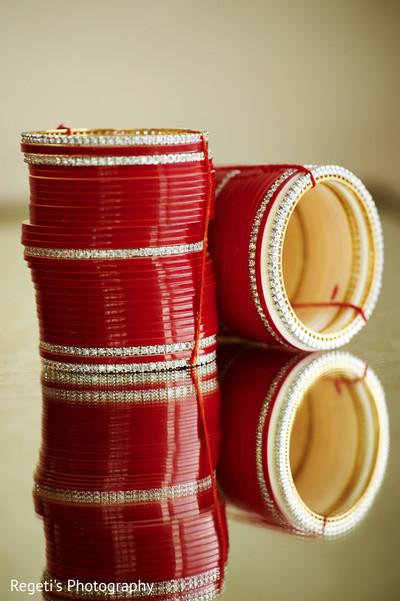 Maharani's red bracelets.
