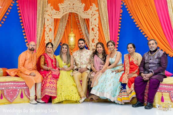 Indian couple and Indian relatives on a decorated stage