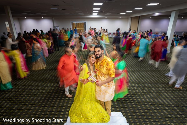 Indian couple embracing on the dance-floor