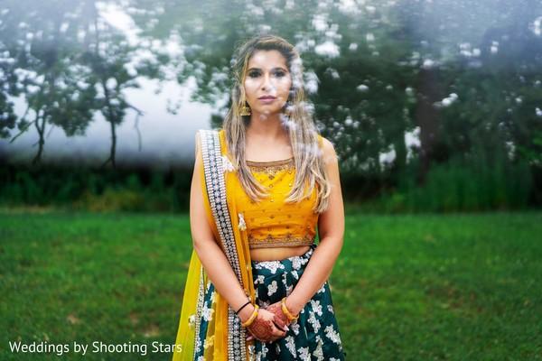 Indian bride posing on a garden