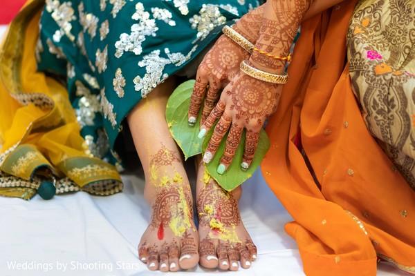 Indian relative applying tumeric on Maharani's feet