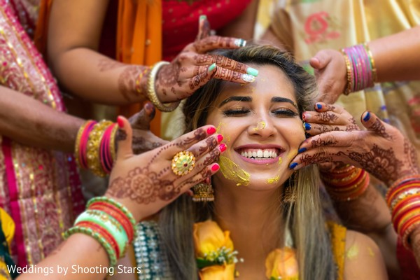 Indian relatives applying tumeric to Maharani's face