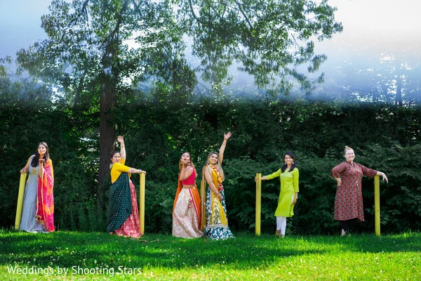 Indian bride and Indian bridesmaids posing at a forest