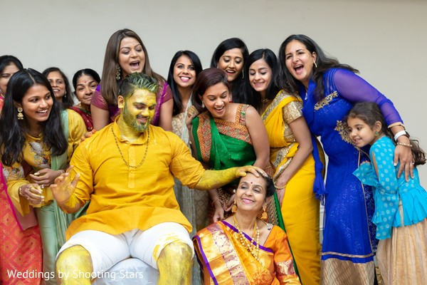 Indian groom covered in tumeric paste