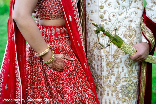 A close up to the Indian couple hands