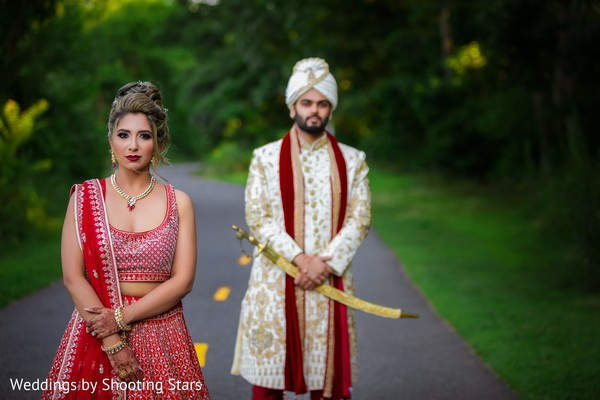 Indian couple posing on a forest road