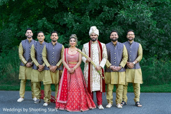 Indian couple posing with the Indian groomsmen