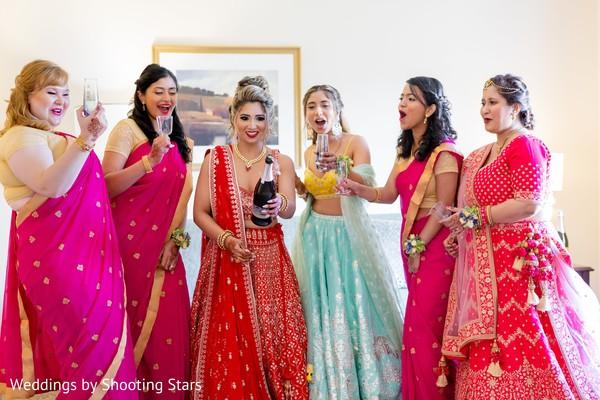 Maharani and Indian bridesmaids sharing a drink