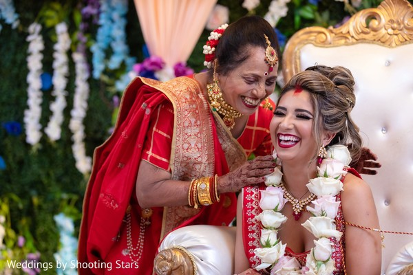 Maharani and her Indian relative laughing during the ceremony