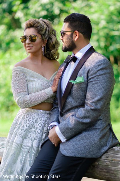 Sunglasses wearing Indian couple posing on the yard