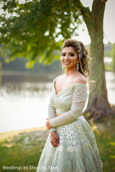 indian bride posing by a lake