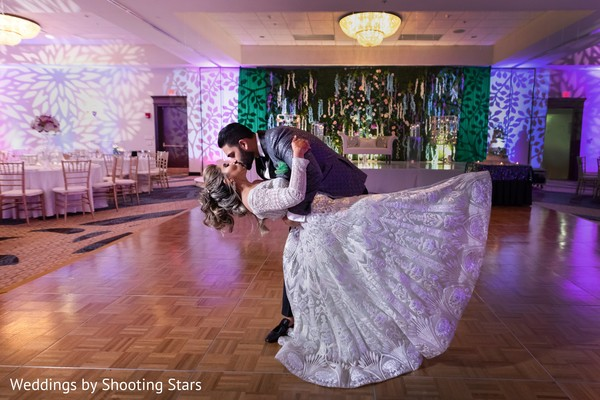 Indian couple ending their dance with a kiss
