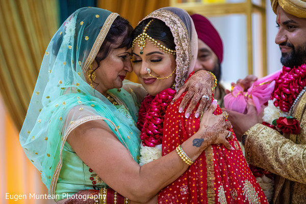 Maharani with mother at Indian wedding ceremony rituals.