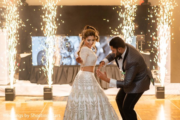 Indian newlyweds dancing