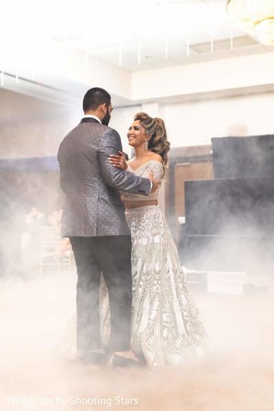 Indian newlyweds dancing in the haze