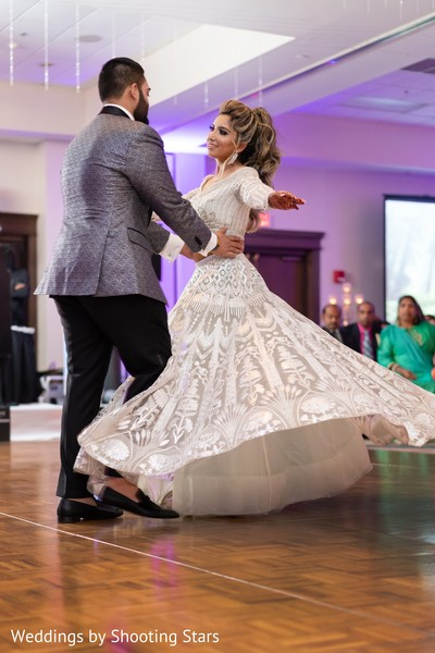 Indian bride enjoying herself while dancing with her Indian groom