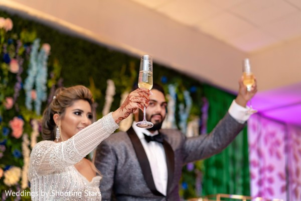 Indian newlyweds toasting