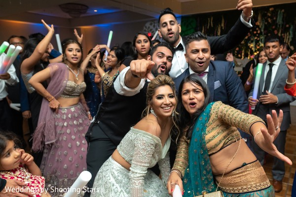 Indian relatives and guests enjoying the party