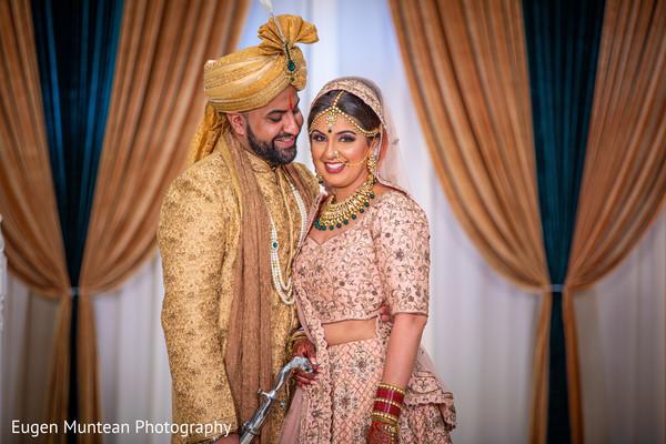 Indian groom smiling at Maharani
