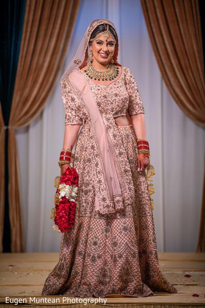 indian bride smiling at photo shoot