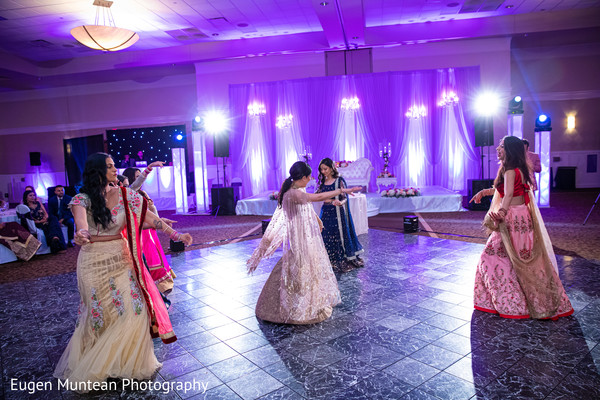 Indian bride and Bridesmaids dancing