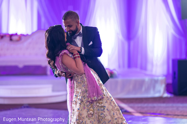 Indian bride and groom dancing at wedding reception