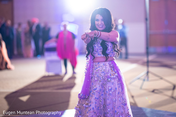Indian bride dancing at the reception