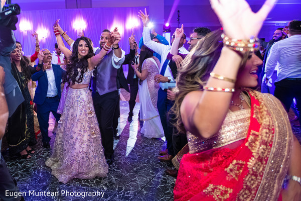 Indian bride and Indian groom wedding reception first dance