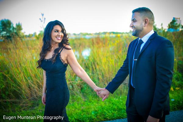 Indian newlywed couple walking at photo shoot