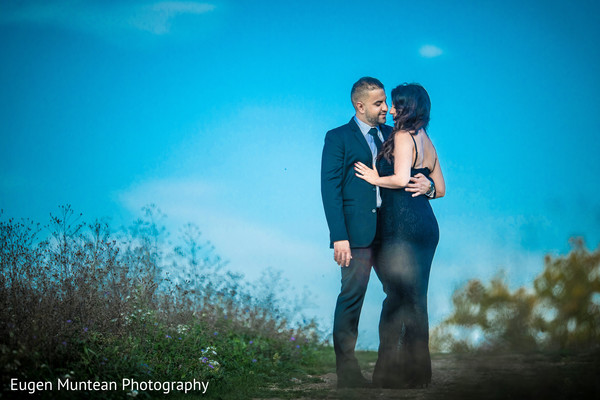 Indian newlyweds staring at each other during photo shoot
