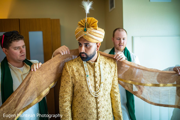 Raja getting his yellow and golden wedding ceremony outfit.
