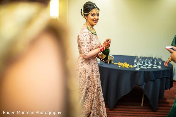 Indian bride sharing Shampaign capture.