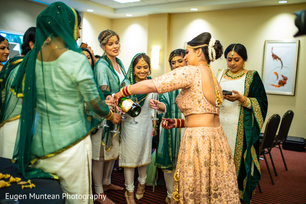 Indian bride with bridesmaids having a toast.