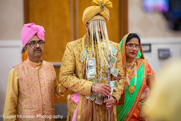 Indian groom making his big entrance to ceremony.