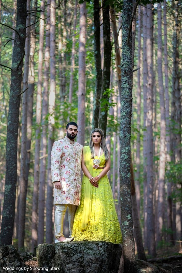 Indian couple posing at a forest
