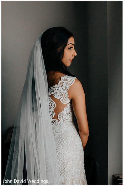 Indian birde wearing her white wedding ceremony veil.