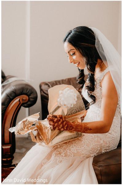 Maharani opening her wedding present.