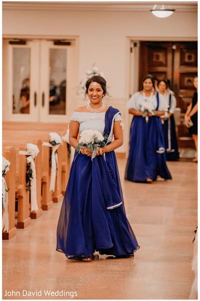 Indian bridemaid on her white and blue lehenga.