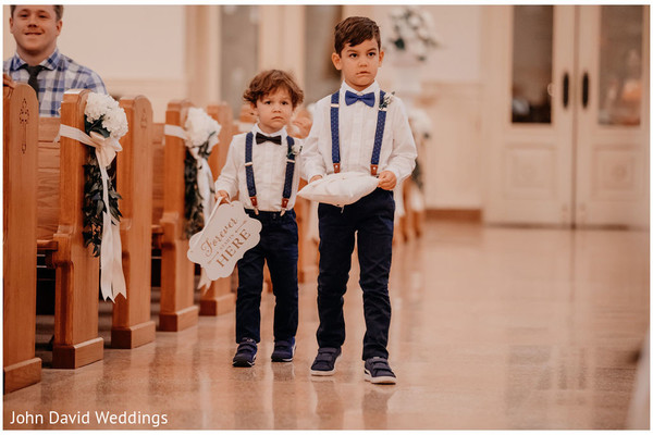 Indian wedding page boys walking down the aisle.
