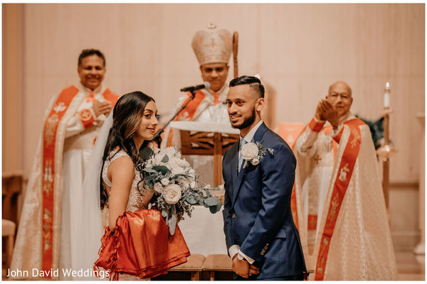Indian couple at wedding altar.