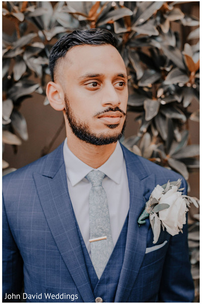 Raja in his blue wedding ceremony tuxedo.