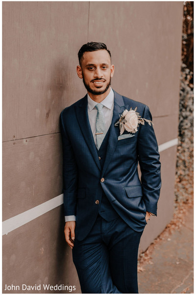 Indian groom with his white rose Boutonniere.