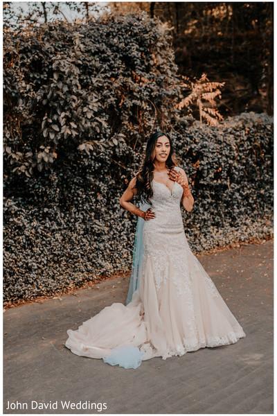 Indian bride posing outdoors.