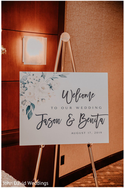 Indian wedding personalized white wellcome sign.