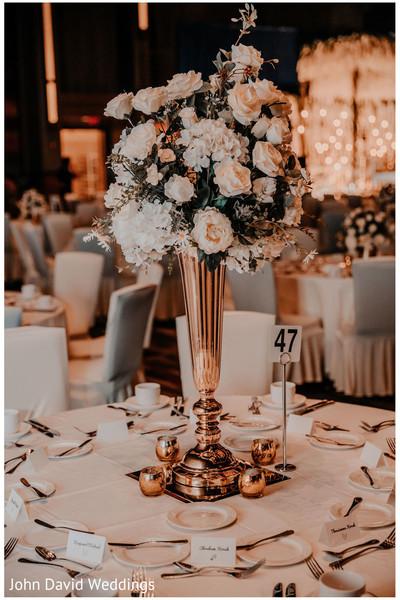 Indian wedding reception table bronze centerpiece decoration.